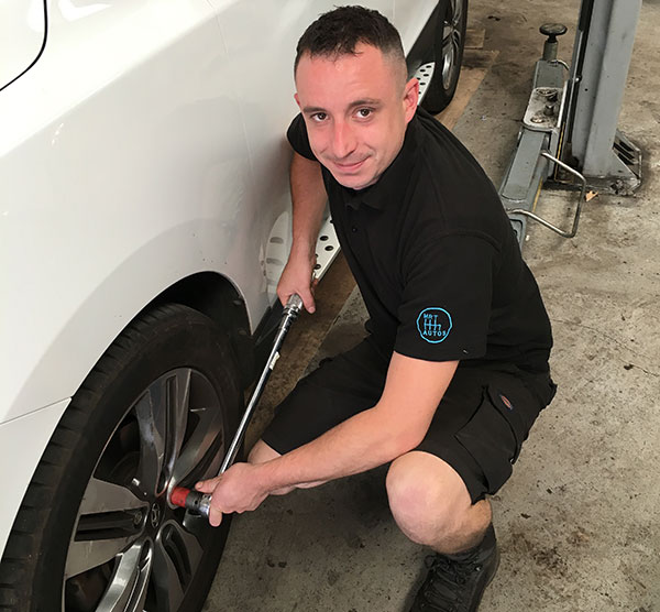 Ben of Mr T Autos fixing a tyre
