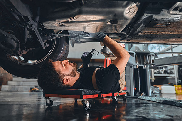 mechanic under the chassis